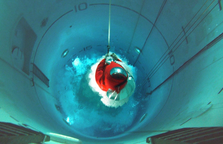 A Royal Navy submariner rises through the tank in 2004