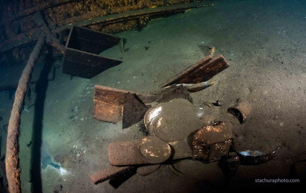 A chamber decorated in amber panels backed with gold leaf and mirrors on Karlsruhe Shipwreck