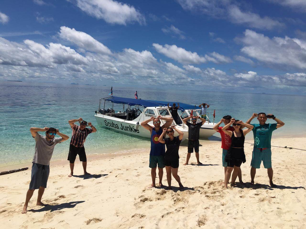 Happy Scuba Junkie Divers at Pulau Sipadan. The group had just seen scalloped hammerhead sharks - a rare species - on a dive. (Photo credit: M Wendels)