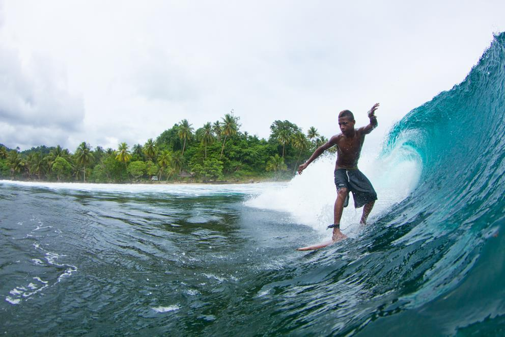 Surfing off Vanimo Surf Lodge