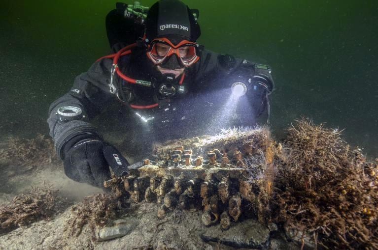 Enigma machine discovered by ghost net team Christian Howe of Submaris