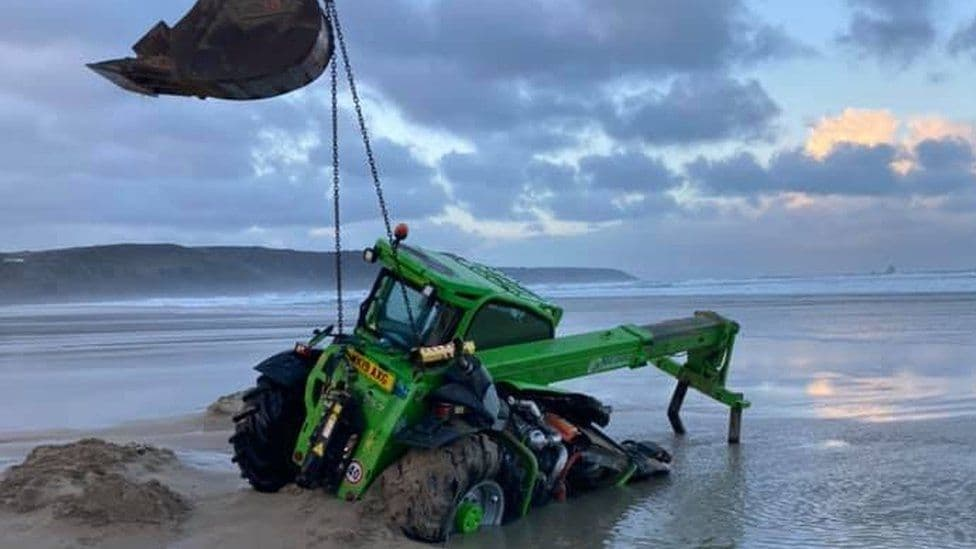 telehandler attempting to remove a dead pilot whale off Perranporth Beach