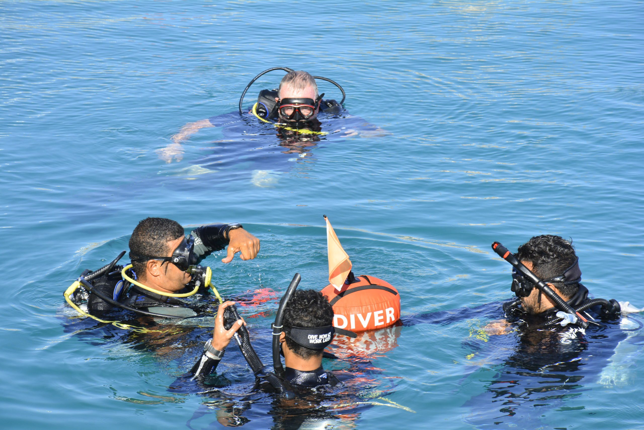 Ahmed Abd El Hakam delivering one of his planned open water lessons to Mahmoud Ibrahim and Moustafa El Shamy during a BSAC Instructor Crossover Course. Adrian Collier, BSAC National Instructor, observes