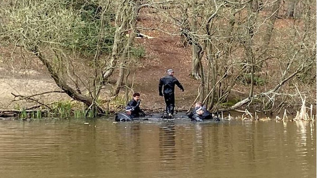 Police divers scouring a pond in Epping Forest as part of the search for a missing student