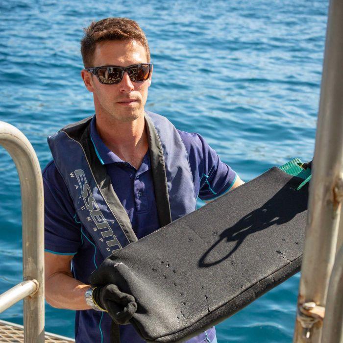 Professor Charlie Huveneers, with Shark proof materials